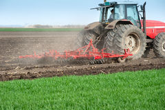 Tractor plowing the fields Stock Photo