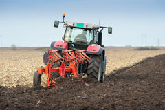 Tractor plowing the fields Stock Images