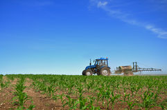 Tractor plowing the fields Royalty Free Stock Images