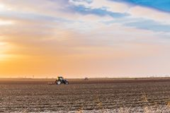Tractor plowing fields Stock Images