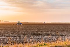 Tractor plowing fields Royalty Free Stock Images