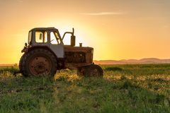 Tractor plowing fields. stock photo