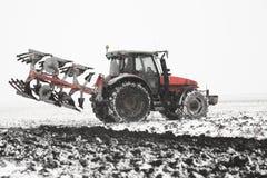 Tractor plowing fields -preparing land stock image