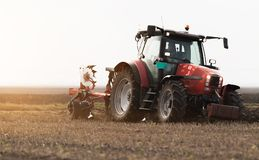 Tractor plowing fields -preparing land for sowing in autumn stock photography