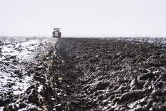Preparing land for sowing in snow royalty free stock photos