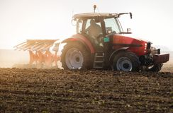 Tractor plowing fields -preparing land for sowing in autumn Royalty Free Stock Photos