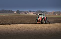 Tractor plowing fields -preparing land for sowing in autumn royalty free stock image
