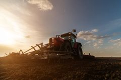 Tractor plowing fields -preparing land for sowing in autumn Royalty Free Stock Photo