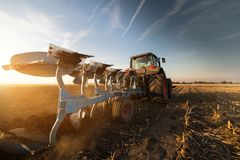 Tractor plowing fields  -preparing land for sowings Royalty Free Stock Images