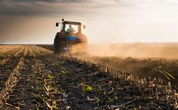 Tractor plowing fields  -preparing land for sowings Royalty Free Stock Photography