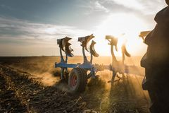 Tractor plowing fields  -preparing land for sowings Stock Photos