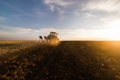 Tractor plowing fields  -preparing land for sowings Stock Images
