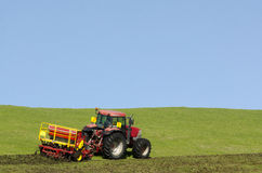 Tractor plowing the ground Royalty Free Stock Images