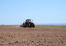 Tractor plowing land Royalty Free Stock Image
