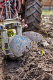 Tractor plowing the land Stock Photography