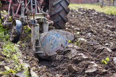 Tractor plowing the land Stock Images