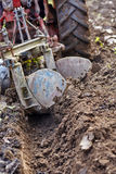 Tractor plowing the land Royalty Free Stock Photos