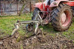 Tractor plowing the land Stock Photos