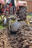 Tractor plowing the land Royalty Free Stock Photography
