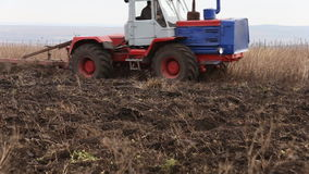 Tractor plowing land stock footage