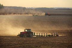 Tractor Plowing. The tractor plowing the land at sunset stock photo