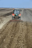Tractor plowing Stock Photo
