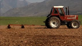 Tractor plowing for planting crop havest stock footage