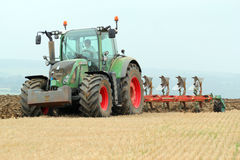 Tractor plowing or ploughing a field. Royalty Free Stock Photos