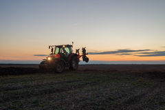 Tractor plowing Stock Images