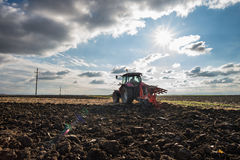 Tractor plowing royalty free stock images