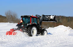 Tractor Plowing Snow on a Yard Royalty Free Stock Photos