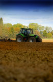 Tractor plowing the soil Royalty Free Stock Photo