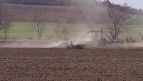 Tractor plowing soil to prepare field for seeding season