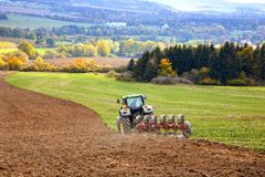 Free Tractor Plowing The Field Stock Image - 142502101