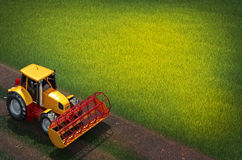 Tractor plows a field. 3d illustration of tractor plows a field Stock Images