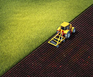 Tractor plows a field. 3d illustration of tractor plows a field Stock Photos