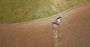 Aerial view of Tractor plowing fields -preparing land for sowing. Tractor plows a field in the spring and prepares the land for sowing. The concept of agronomy Royalty Free Stock Photo