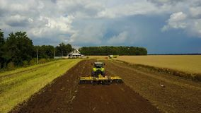 Tractor Plows The Field stock footage