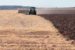 Tractor plows the land. Tractor plows the autumn land Stock Photos