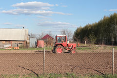 The tractor that plows. The tractor plowing a field Royalty Free Stock Photography