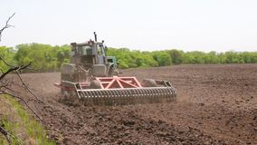 The tractor plows the soil. stock video footage