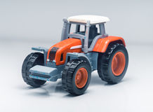 Tractor plástico del juguete de los niños Fotografía de archivo