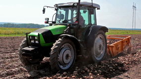 Tractor and potato digger stock video footage
