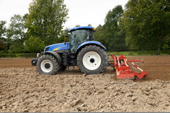 Tractor With Power Harrow Side View Stock Images