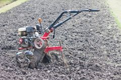 Tractor prepares ground for planting Royalty Free Stock Image