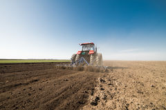 Tractor preparing land Royalty Free Stock Photography