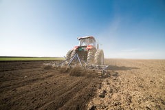 Tractor preparing land Stock Images