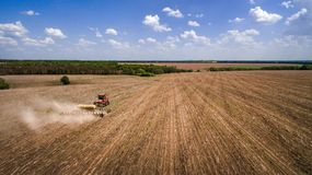Tractor preparing land for sowing sixteen rows aerial, concept of cultivation, sowing, plowing field, tractor and production autom. Ation, place for text stock photo