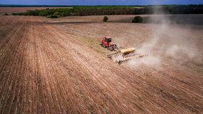 Tractor preparing land for sowing sixteen rows aerial, concept of cultivation, sowing, plowing field, tractor and production autom. Ation, place for text royalty free stock photo