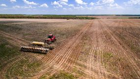 Tractor preparing land for sowing sixteen rows aerial, concept of cultivation, sowing, plowing field, tractor and production autom. Ation, place for text royalty free stock photos